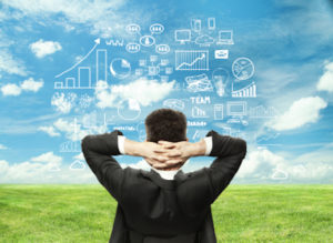 businessman looking at business strategy on field background